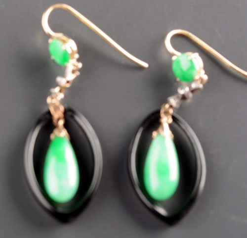 Lot 828-A pair of jadeite earrings, the torpedo-shaped...
