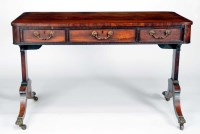 Lot 1011-A Regency rectangular rosewood centre table, the...