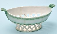 Lot 634-Sewell part green glaze moulded basket of 'North...