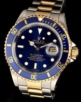 Lot 832-Rolex Oyster Perpetual Date Submariner: a gold...