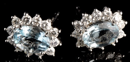 Lot 1005-A pair of aquamarine and diamond cluster earrings,...