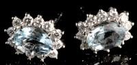 Lot 1005 - A pair of aquamarine and diamond cluster...