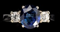 Lot 1008 - A sapphire and diamond ring, the oval facet...