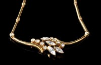 Lot 1010 - A diamond and 18ct. yellow gold necklace, set...