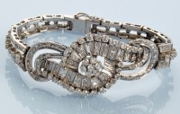 Lot 1010A - A diamond bracelet, set throughout with...