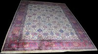 Lot 1015 - A Tabriz carpet, the ivory ground decorated...