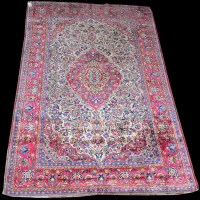 Lot 1017 - A Kashan silk rug, the central medallion and...