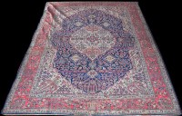Lot 1018 - A West Persian carpet, the shaped oval central...