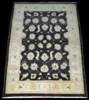 Lot 1021 - An Afghan rug, with Ziegler style leaf head...