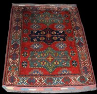 Lot 1022 - A Caucasian rug, with three shaped medallions...