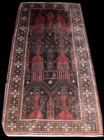Lot 1024 - A Balouch rug, decorated with arches, deer and...