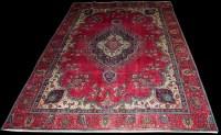 Lot 1027 - A Tabriz carpet, the central floral medallion...