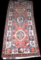 Lot 1028 - An Iranian village rug, with shaped medallion...