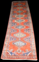 Lot 1029 - A Persian runner, with eight diamond-shaped...