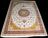 Lot 1032 - A machine woven bamboo silk carpet, with...