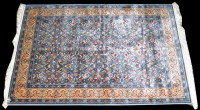 Lot 1033 - A machine woven Kashmiri rug, with floral...