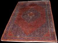 Lot 1036 - A Persian style carpet, of Shiraz type design,...