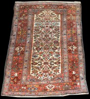 Lot 1038 - A Hamadan rug, the ivory ground decorated with...