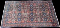 Lot 1039 - A West Persian rug, the field decorated with...