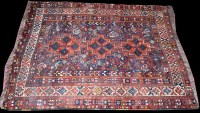 Lot 1041 - A Shiraz rug, with triple medallion to field...