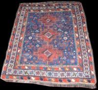 Lot 1043 - A Shiraz rug, three medallions, the field...