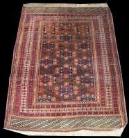 Lot 1046 - A Turkoman rug, with diamond-shaped medallions...