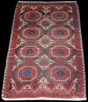 Lot 1047 - A Balouch rug, with eight teke style...