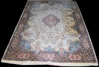 Lot 1048 - A Nain carpet, the central rosette on blue...