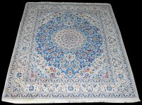 Lot 1049 - An Indian Persian style carpet, the central...