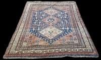 Lot 1056 - A Quashqai rug, with triple medallion design...