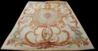 Lot 1057 - An Aubusson carpet, with central rosette...