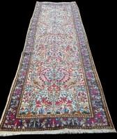 Lot 1059 - A Kirman runner, decorated throughout with...