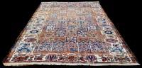 Lot 1060 - A Persian Bakhtiari carpet, decorated with...
