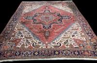 Lot 1062 - A Heriz carpet, with bold geometric floral...