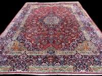 Lot 1065 - A Kashan carpet, the central diamond-shaped...
