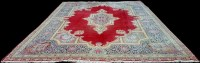 Lot 1066 - A Kirman carpet, the central foliate medallion...