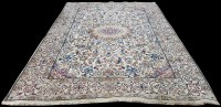 Lot 1067 - A Nain carpet, the small medallion surrounded...