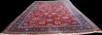 Lot 1072 - A Tabriz carpet, with bold floral motifs on...
