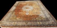Lot 1073 - A Tabriz carpet, the central rosette medallion...