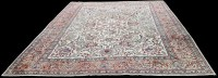 Lot 1074 - A Tabriz carpet, the ivory ground with bold...