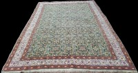 Lot 1075 - A Kayseri carpet, the green ground with...