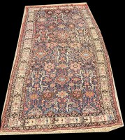 Lot 1076 - A Caucasian carpet, decorated with bold floral...