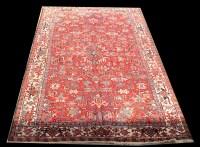 Lot 1077 - A Heriz carpet, with geometric floral design...