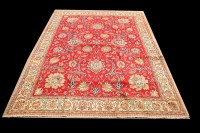 Lot 1079 - A Tabriz carpet, the red ground with bold...
