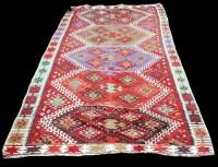 Lot 1081 - A Caucasian Kilim carpet, with bold geometric...