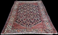 Lot 1082 - A Darjazin rug, the black ground with...