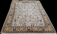 Lot 1084 - A Tabriz carpet, the ivory ground with floral...