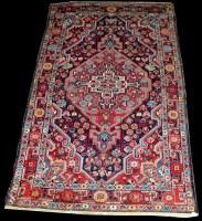 Lot 1090 - A Jozan rug, with geometric flowerhead motifs...