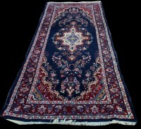 Lot 1091 - A Mehraban runner, with floral medallion and...