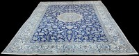 Lot 1092 - A Nain carpet, the central rosette surrounded...